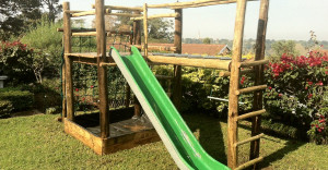 Milky Way: Platform, mini monkey bars, fibreglass slide, cargo net, sand pit